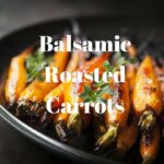 Balsamic Roasted Carrots on plate with parsley garnish